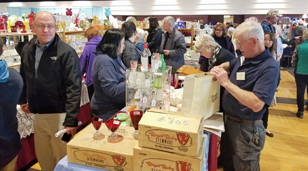 People shopping at a depression glass show in Michigan