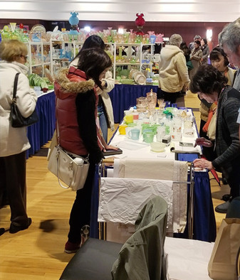 People shopping at a depression glass show in Michigan.