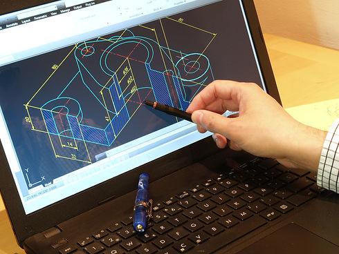 designer working on a cad blueprint   .j