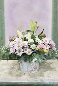 Arreglo floral en una caja decorativa