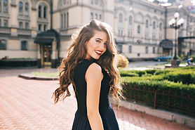 Portrait from back of elegant girl with