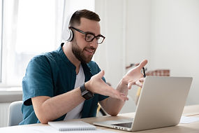 Smiling businessman in headphones lookin