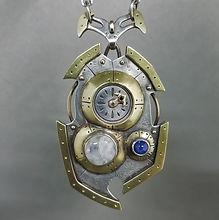 Powered pendant.moonstonesapph.front.jpg