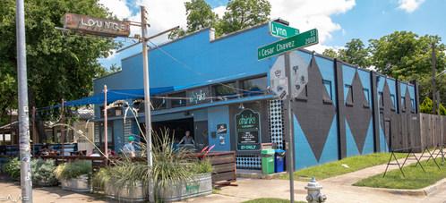 The blue building at the corner of E. Cesar Chavez & Lynn.