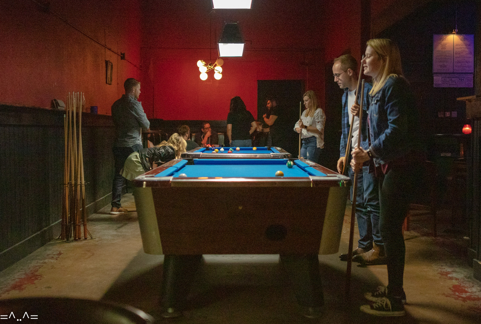 Grab some friends for a game of pool in our red room.