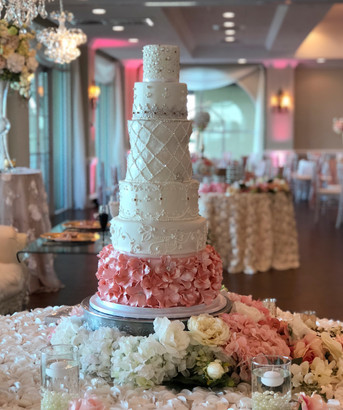 Blush and white wedding cake covered in Swarovsky crystals