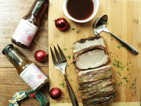 Plum-Glazed, Bacon-Wrapped Pork Loin with Black Pepper-Dried Cranberries