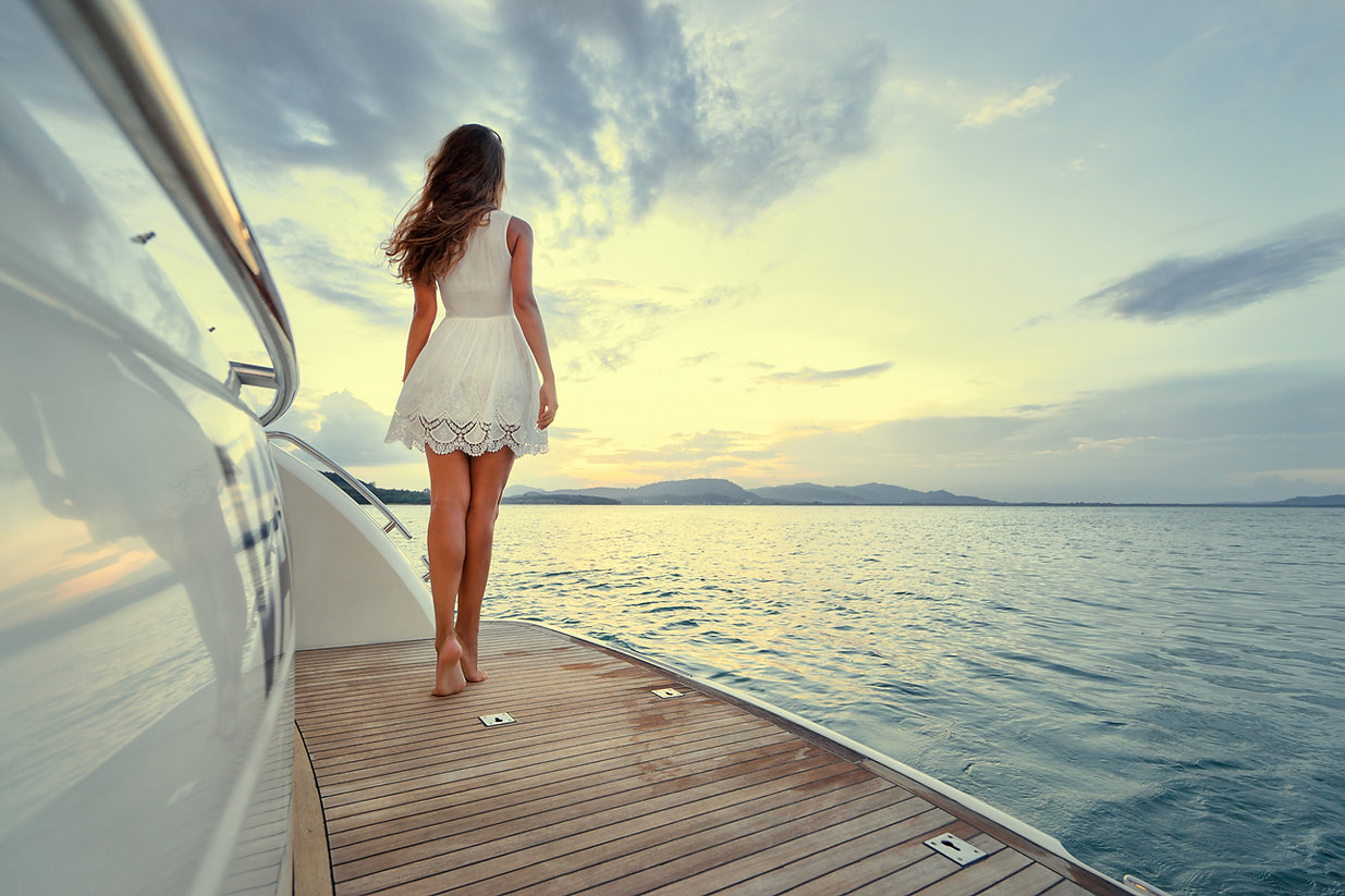 Luxury travel on the yacht. Young woman