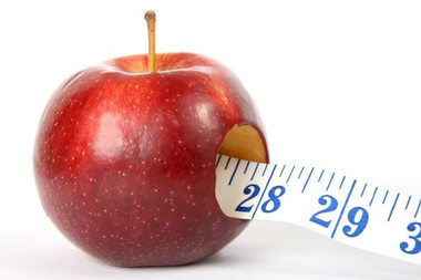 benefits of healthy lifestyle: a photo of a measuring tape inside an apple