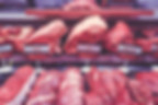 healthy eating grocery list: a photo of a butcher shop meat display