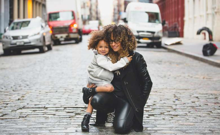 healthy lifestyle: photo of a happy lady with her kid