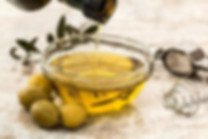 Foods that Boost Testosterone: a photo of a bowl with olive oil on a table