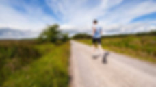 healthy lifestyle changes: a photo of a man running down the road