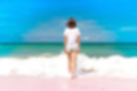 healthy lifestyle importance: a photo of a fit woman walking on the beach