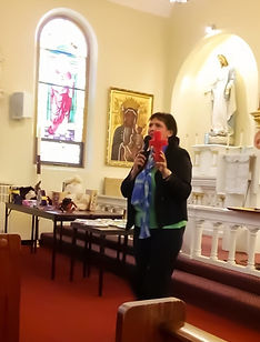 Joanne%20preaching%20with%20Cross_edited