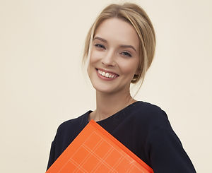 smiling%20woman%20standing%20while%20holding%20orange%20folder_edited.jpg