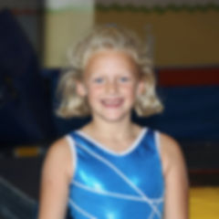Young female gymnast smiling