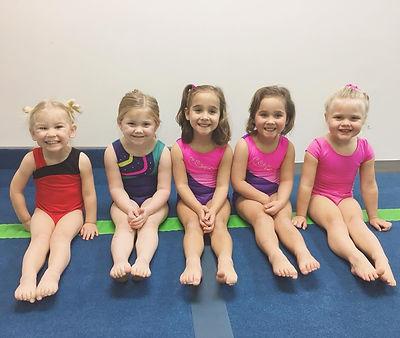 Five smiling preschoolers