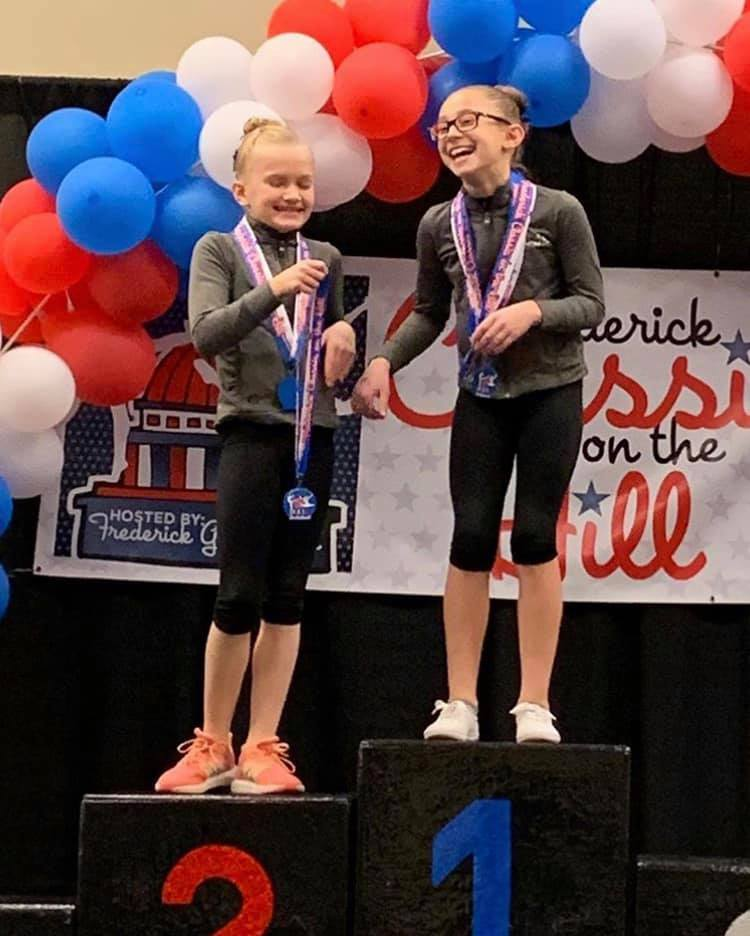 best friend gymnasts smiling