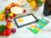 Organic food and a Tablet PC showing inf