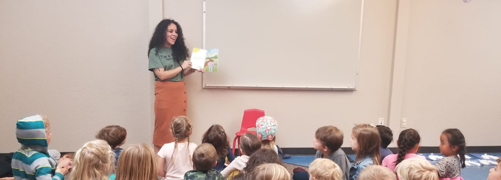 Katherine reading Rayna's Story to the students at The Lighhouse School-Winter Garden
