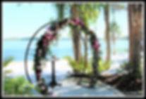 Flowered lakeside wedding altar Paradise Cove Orlando