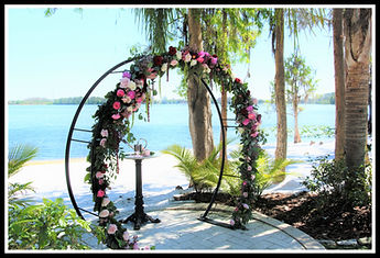 Flowered lakeside wedding altar Paradise Cove Orlando