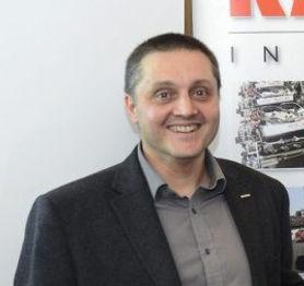 Arnaud-Martin-receiving-award-from-SK-e1