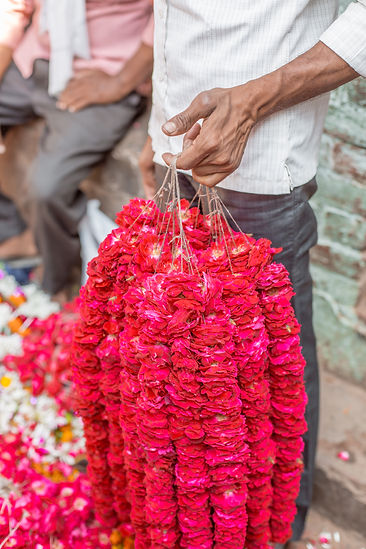 Pink flower garlands at colourful flower market in Varanasi India