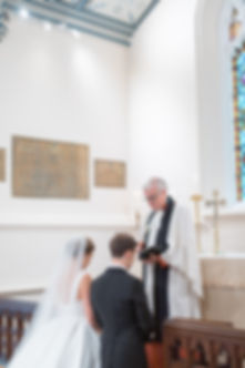 Bride and groom at alter during English church wedding cermony
