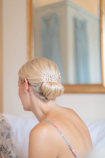 Bridemaid hairstyle inspiration low bun with pearl clip
