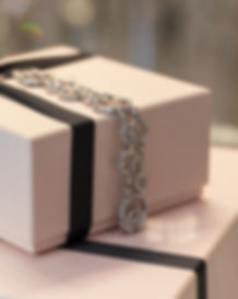 Boodles jewellery pink packaging with diamond bracelet