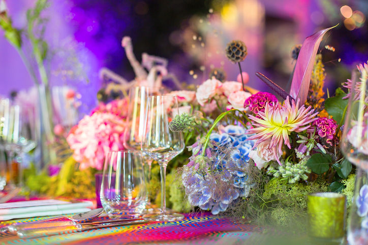 Colourful pink and blue tablescape flowers