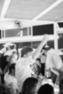 Napkin spinning and dancing at traditional greek restaurant Sea Satin Mykonos