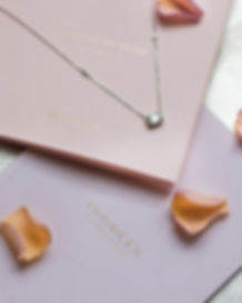 Boodles jewellery lifestyle shoot with diamond necklace and petals
