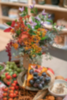 Autumnal flowers and cheese board platter event catering
