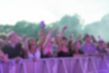 Front of festival crowds dancing with golden sunlight at Soho House Festival