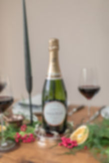 Laurent Perier champagne on wooden table with foliage runner with grey candlesticks for autumnal winter tablescape styled shoot inspiration
