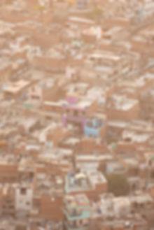 Golden sunset light over favelas in Jaipur India