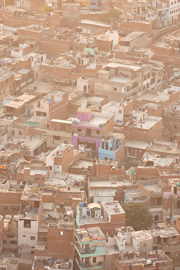 Golden sunset light over favelas in Jaipur India