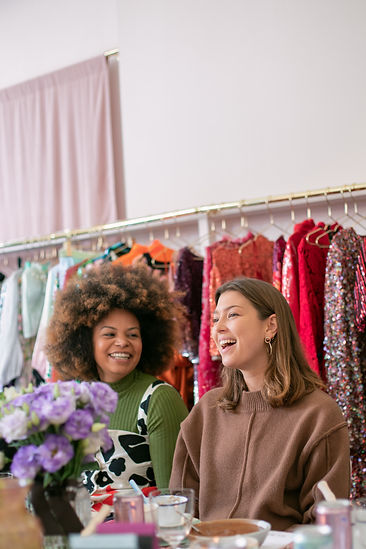 Danielle Copperman and Emma Edmondson laughing at sustainable influencer breakfast hosted by Hurr