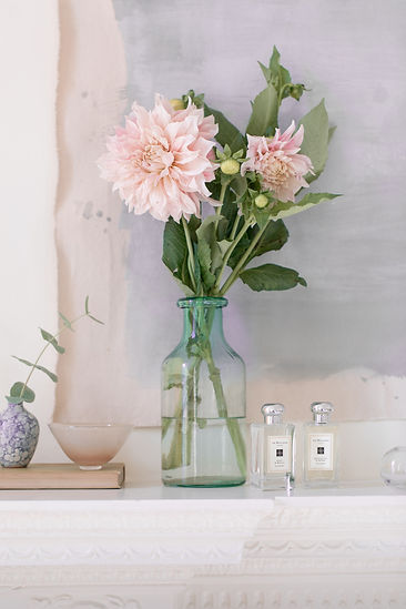 Poppy and Barley fragrance still life lifestyle shoot on mantlepiece with light pink dalia flowers