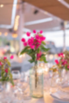 Greek wedding tablescape with pink flowers at Sea Satin Mykonos