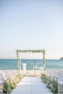 Green and white Greek beach wedding ceremony in Mykonos