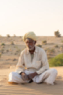 Indian man sitting Jaisalmer desert India