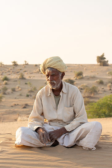 Indian man sitting Jaisalmer desert India