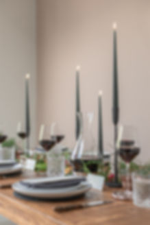 Long wooden table with foliage runner with grey candlesticks for autumnal winter tablescape styled shoot inspiration