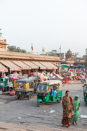 Colourful busy street market in India with Rickshaws