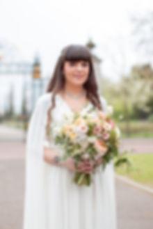 Bride with flower boquet in Regent's Park luxury London wedding photographer