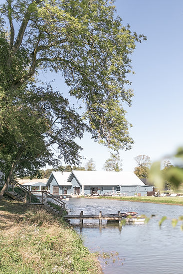 Boathouse and swimming pool at Soho Farmhouse in Cotswolds Oxfordshire